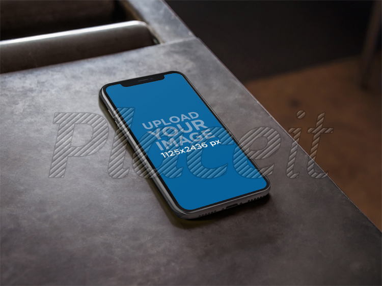 Placeit Iphone X Mockup Lying On A Metal Work Table