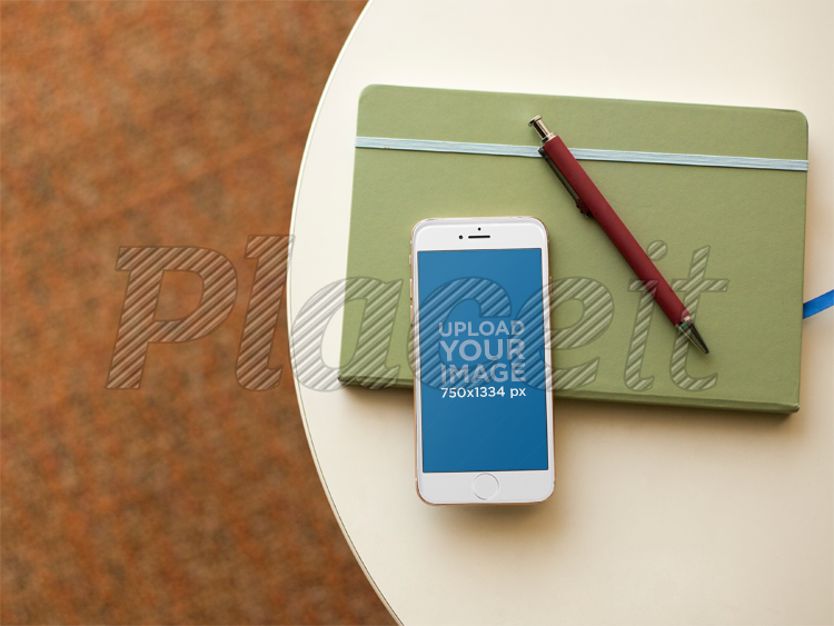 Placeit White Iphone 6 Mockup On A Table With A Notebook