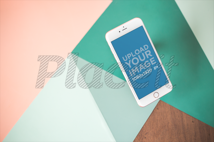 Placeit Iphone Mockup Floating Over A Wooden Table With Green And