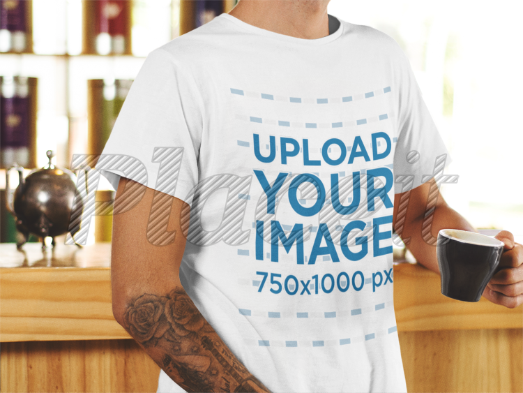 3eddb60caa1 T-Shirt Mockup of a Young Man Holding a Cup of Coffee 1061aForeground Image