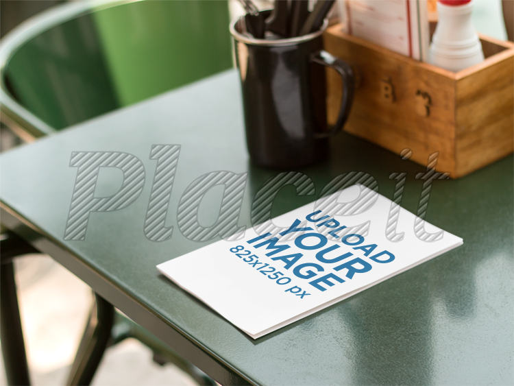 bifold brochure mockup of a menu lying on top of table a10319foreground image