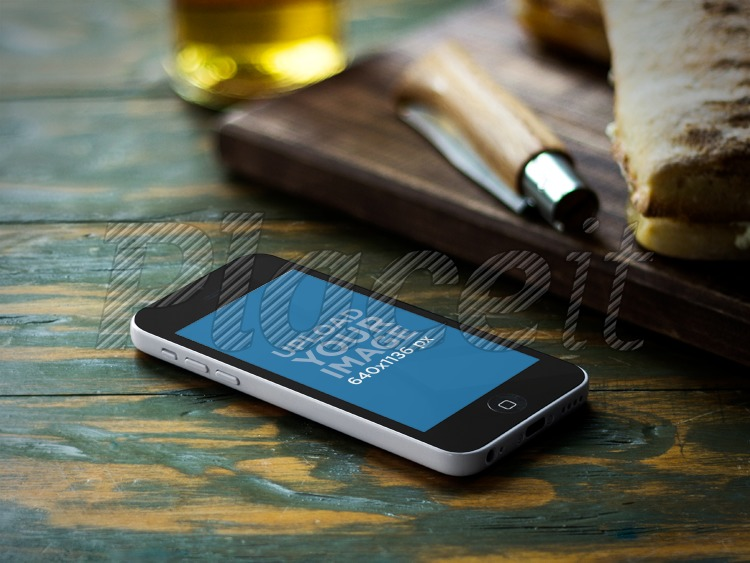 Placeit Iphone Mockup White 5c Over Wooden Bistro Table